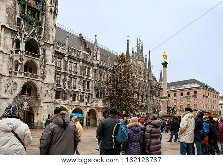MUNICH GERMANY - JANUARY 01 2011 - Many people watch the show vintage chimes on the tower of the New Town Hall in Munich