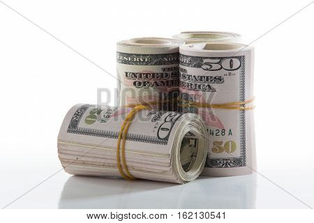 American Fifty Dollar Bills Rolled Up With A Rubber Band
