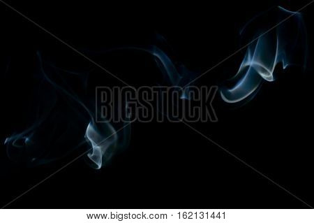 Blue abstract smoke art plume going from left to right on a black background
