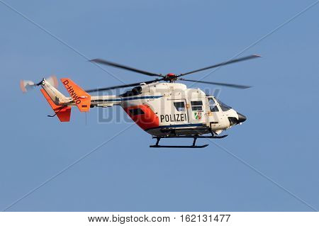 DUSSELDORF GERMANY - DEC 16 2016: Eurocopter BK117 helicopter from the German Police in flight