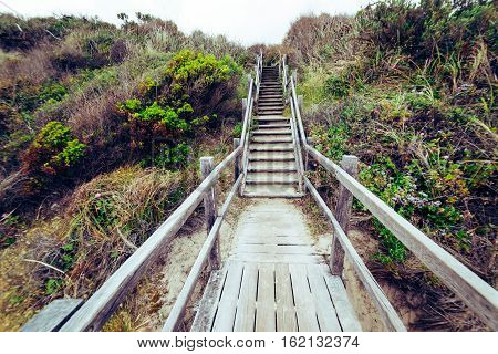 Steps leading down to beach at .Torndirrup National Park Albany Western Australia Australia.vintage toning filter add .