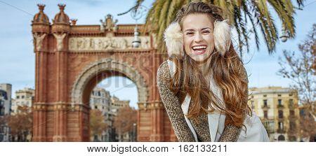 Happy Elegant Woman In Earmuffs In Barcelona, Spain Standing