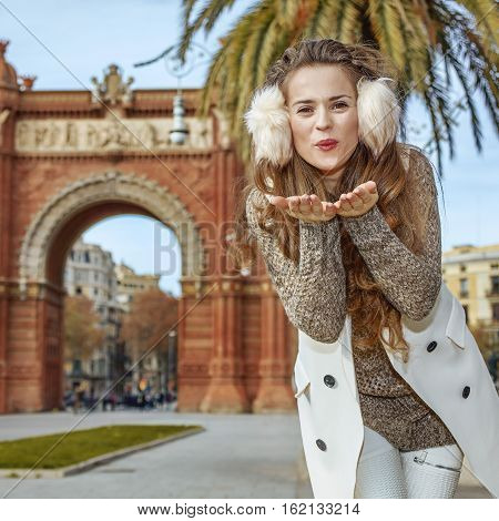 Smiling Fashion-monger In Barcelona, Spain Blowing Air Kiss