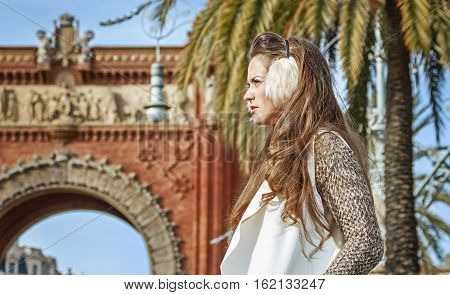 Fashion-monger Near Arc De Triomf Looking Into Distance