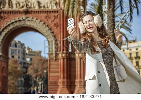 Fashion-monger Taking Selfie And Showing Victory Gesture