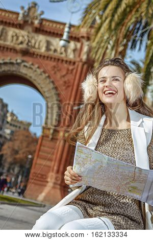 Fashion-monger In Barcelona With Map Looking Into The Distance