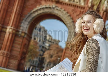 Woman Near Arc De Triomf With Map Looking Into Distance
