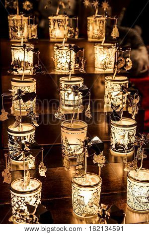 Christmas decorations in the shape of small lamps with different designs.