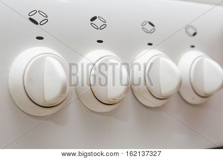 Dirty Knobs Of The Gas Stove In Home Kitchen
