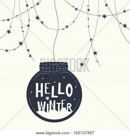 The cover design. Glass globe with stars and phrase hello winter inside. At the top of the card garland with stars.