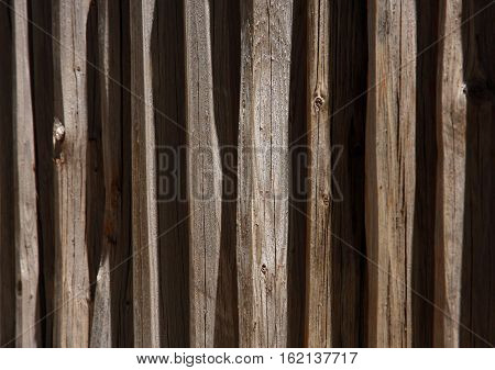 Lines and shadows of a wooden fence form a geometric abstract image