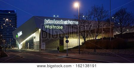 Basingstoke, UK. 18th December 2016. People are seen wandering around the outside of the recently opened John Lewis & Waitrose at home superstore by the Basing View shopping centre in Basingstoke.