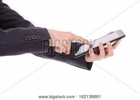 Boy in a suit sitting and holding a tablet PC (pointing finger) isolated on white