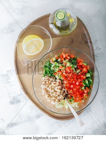 Quinoa tabbouleh salad on a wooden table.
