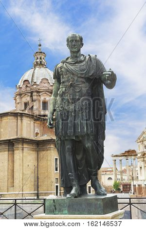 Bronze statue of emperor Julius Caesar over Temple of Venus Genetrix in Rome Italy