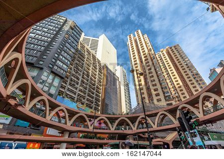 Hong Kong, China - December 6, 2016: characteristic skywalk between Pennington Street and Yee Wo Street in the famous luxury shopping district of Causeway Bay in Hong Kong Island.