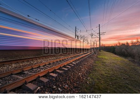 High Speed Passenger Train In Motion At Sunset