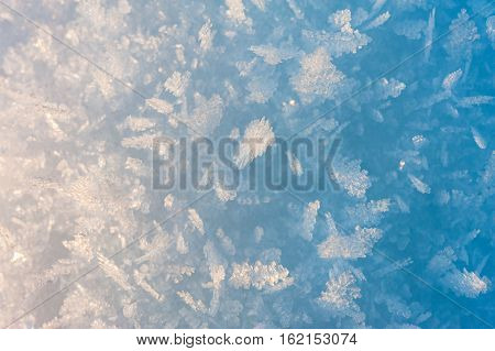 Abstract detail of snow in morning sunlight that has turned into ice crystals in sub-zero winter temperature