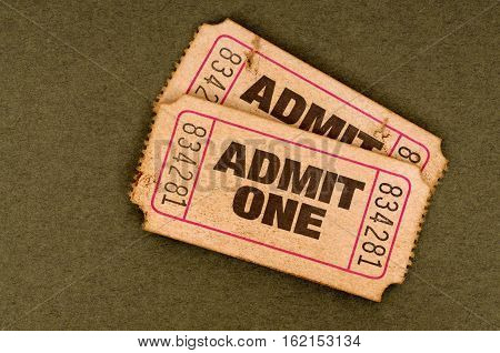 Old torn tickets with admit one text