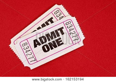 Admit one tickets on red background paper
