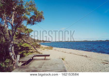 Bench on Coalmine Beach Walpole Australia . vintage toning filter add .