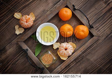 Tangerine Essential Oil In A Glass Bottle