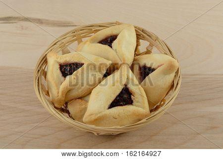 Hamantaschen raspberry pastries in wicker basket on table