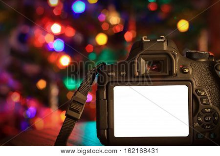 Christmas scene of a digital camera with a blank screen.