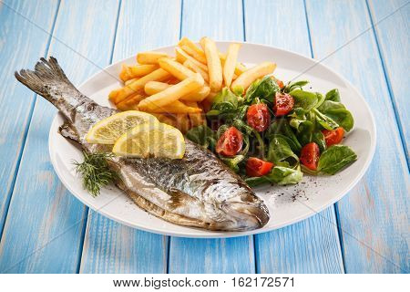 Fish dish - roasted trout with vegetables