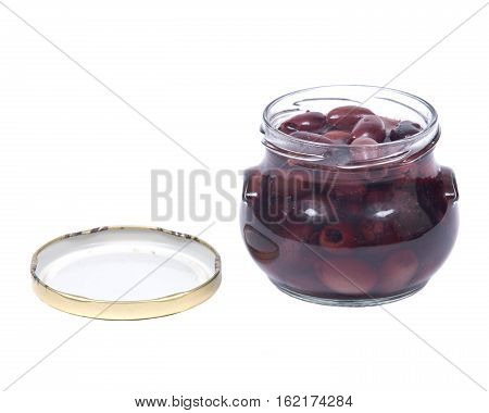Jumbo pitted kalamata olives in jar isolated on white background
