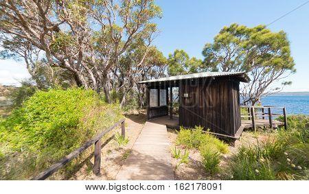 visitor information small wooden house on Coalmine Beach Walpole Australia .