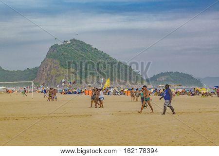 RIO DE JANEIRO, BRAZIL, JANUARY - 2016 - People at copacabana beach in Rio de Janeiro Brazil