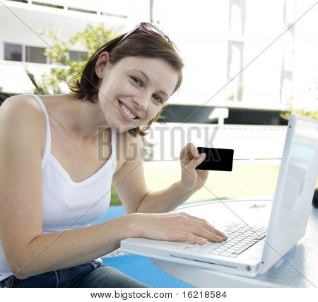 Attractive woman shopping online
