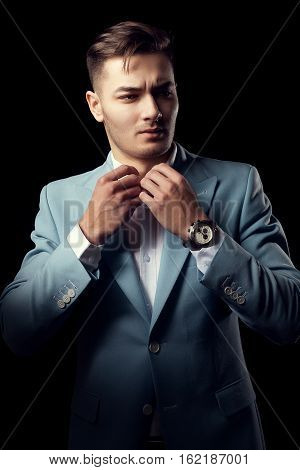 Man In Fashion Suit Looking Cool On Black Background