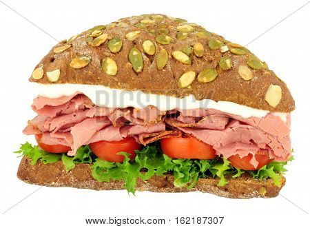 Pastrami and pumpernickel bread sandwich isolated on a white background