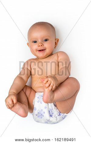Cute Baby In Diaper Lying On Back - Isolated On White