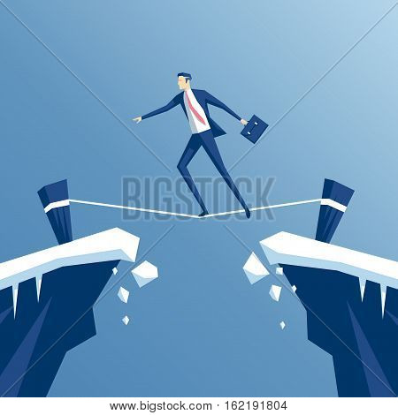 businessman tightrope walker is walking a tightrope across the gap in the rocks an employee is walking a tightrope between two cliffs business concept risk
