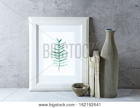 An arrangement of a watercolor picture and a ceramic vase