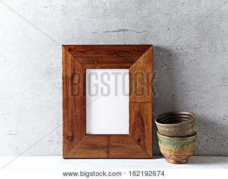 Rustic wooden frame and two japanese ceramic cups