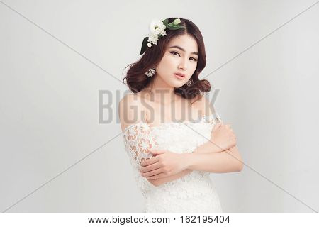 Beautiful Asian Woman Bride On Grey Background