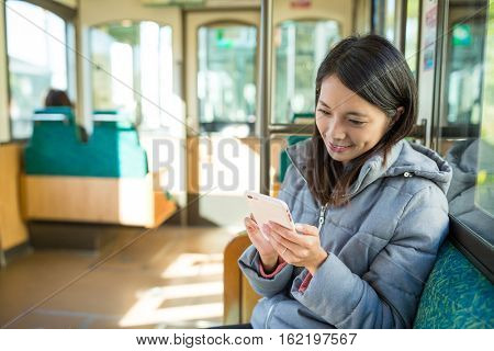 Young woman sending sms on cellphone