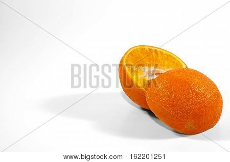 Orange cut in half isolated on a white background.