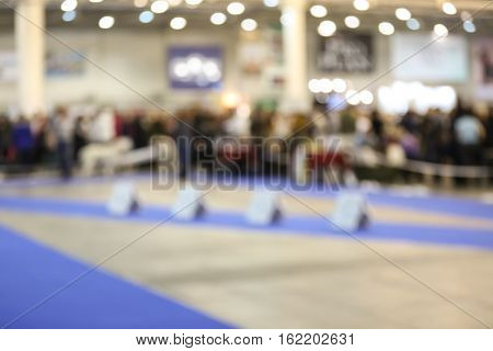 Interior of room prepared for dog show, blurred view