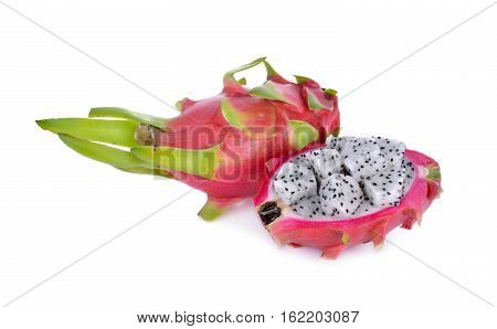 whole and cut fresh dragon fruit on white background