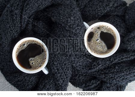Two Cups Of Coffee Wrapped In Black Woolen Scarf