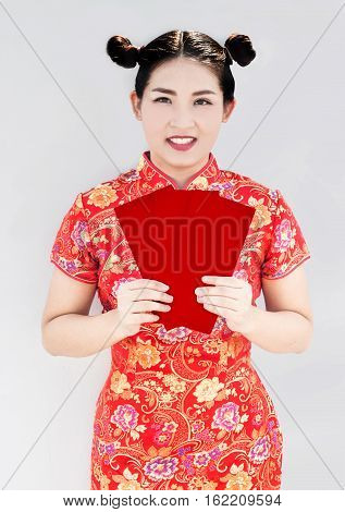 asian girl show red envelop for give in newer festival