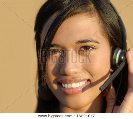 Young attractive bi-racial sales support woman on telephone