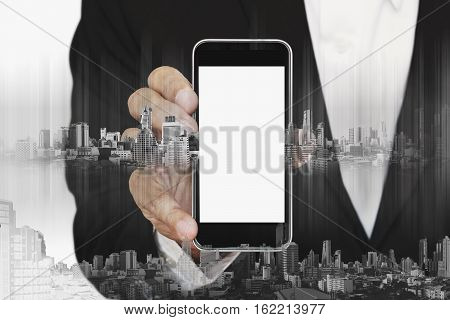 Businessman holding smartphone with with blank copy space on screen, business communication technology concepts