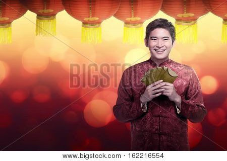 Chinese Man In Cheongsam Suit Holding Angpao