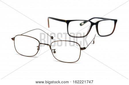 Eyeglasses over white background, close up, shallow DOF